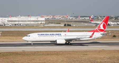 thy: ISTANBUL, TURKEY - JULY 09, 2015: Turkish Airlines Boeing 737-8F2 (CN 29772242) takes off from Istanbul Ataturk Airport. THY is the flag carrier of Turkey with 284 fleet size and 275 destinations