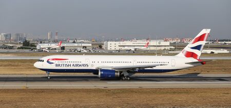boing: ISTANBUL, TURKEY - JULY 09, 2015: British Airways Boeing 767-336ER (CN 29232708) takes off from Istanbul Ataturk Airport. BA is the flag carrier of UK with 293 fleet size and 188 destinations