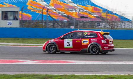 typer: ISTANBUL, TURKEY - NOVEMBER 02, 2014: Ahmet Mutlubas drives Honda Type-R during Turkish Touring Car Championship in Istanbul Park Circuit Editorial