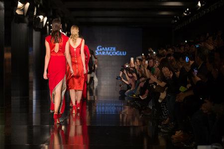the latest models: ISTANBUL, TURKEY - NOVEMBER 22, 2014: Models showcase the latest creations by Gamze Saracoglu in Fashionist fashion fair Editorial