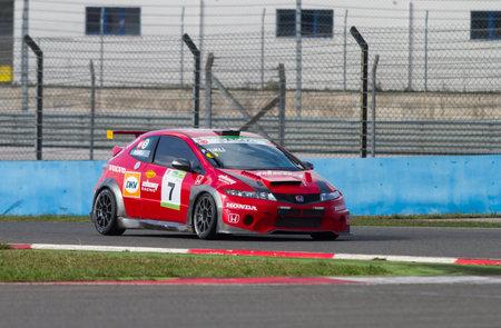 typer: ISTANBUL, TURKEY - NOVEMBER 02, 2014: Peter Rikli drives Honda Type-R during Turkish Touring Car Championship in Istanbul Park Circuit