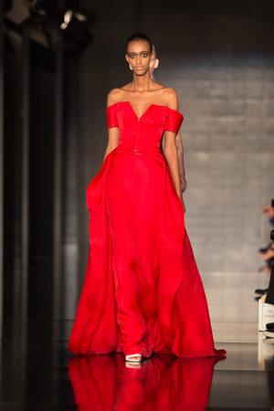 tuba: ISTANBUL, TURKEY - NOVEMBER 20, 2014: A model showcases one of the latest creations by Ezra and Tuba in Fashionist fashion fair
