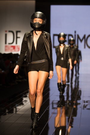 the latest models: ISTANBUL, TURKEY - NOVEMBER 20, 2014: Models showcase the latest creations by Derimod in Istanbul Leather Fair