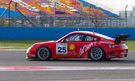atar: ISTANBUL, TURKEY - NOVEMBER 02, 2014: Galip Atar drives Porsche 997 GT 3 of Ulku Motorsport Team during Turkish Touring Car Championship in Istanbul Park Circuit