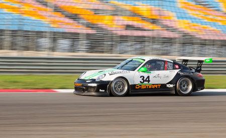motorsports: ISTANBUL, TURKEY - NOVEMBER 02, 2014: Murat Arif Suyabatmaz drives Porsche GT 3 of Go Motorsports Team during Turkish Touring Car Championship in Istanbul Park Circuit Editorial