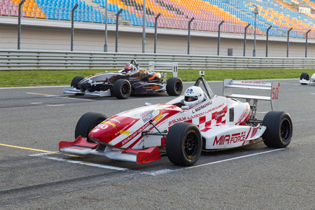 ISTANBUL, TURKEY - NOVEMBER 02, 2014: L. Nadirashvili drives Formula Alfa Car in Istanbul Park Circuit Redactioneel