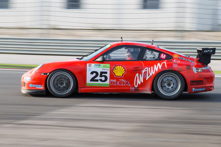atar: ISTANBUL, TURKEY - NOVEMBER 02, 2014: Galip Atar drives Porsche 997 GT 3 of Ulku Motorsport Team during Turkish Touring Car Championship in Istanbul Park Circuit