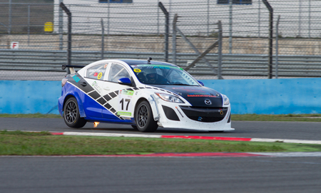 motorsport: ISTANBUL, TURKEY - NOVEMBER 02, 2014: Ismet Toktas drives Mazda 3 of Ulku Motorsport team during Turkish Touring Car Championship in Istanbul Park Circuit