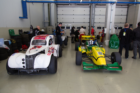 alfa: ISTANBUL, TURKEY - NOVEMBER 02, 2014: Formula Alfa and Legends car in garage during Turkish Touring Car Championship in Istanbul Park Circuit