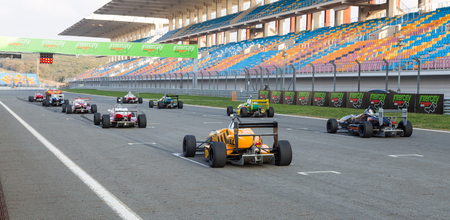 cars race: ISTANBUL, TURKEY - NOVEMBER 02, 2014: Formula Alfa Cars in start line of Istanbul Park Circuit