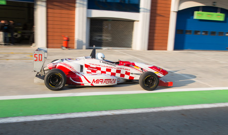 alfa: ISTANBUL, TURKEY - NOVEMBER 02, 2014: L. Nadirashvili drives Formula Alfa Car in Istanbul Park Circuit Editorial