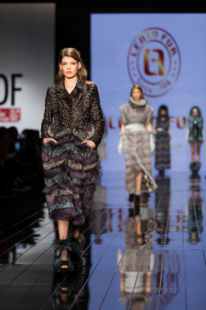 the latest models: ISTANBUL, TURKEY - NOVEMBER 20, 2014: Models showcase one of the latest fashion creations in Istanbul Leather Fair