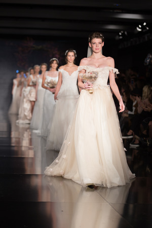 the latest models: ISTANBUL, TURKEY - NOVEMBER 22, 2014: Models showcase the latest creations by Banu Guven in Fashionist fashion fair
