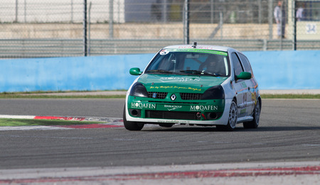 suleyman: ISTANBUL, TURKEY - NOVEMBER 02, 2014: O. Suleyman Berkel drives Renault Clio during Turkish Touring Car Championship in Istanbul Park Circuit Editorial