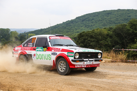 deniz: ISTANBUL, TURKEY - JULY 25, 2015: Engin Kap drives Ford Escord MK2 of Bonus Unifree Parkur Racing Team in Bosphorus Rally 2015, Deniz stage