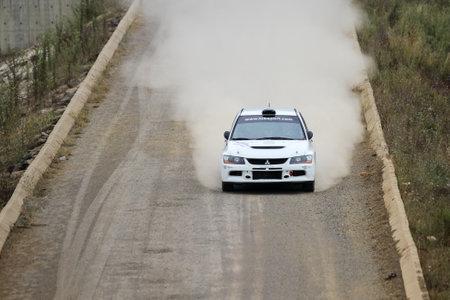 deniz: ISTANBUL, TURKEY - JULY 25, 2015: Menderes Okur drives Mitsubishi Lancer Evo IX of Tok Sport WRT Team in Bosphorus Rally 2015, Deniz stage Editorial