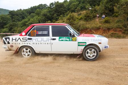 deniz: ISTANBUL, TURKEY - JULY 25, 2015: Emre Hasbay drives Tofas Fiat 131 of Delta Sport Team in Bosphorus Rally 2015, Deniz stage