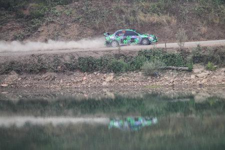 deniz: ISTANBUL, TURKEY - JULY 25, 2015: Umit Erdim drives Mitsubishi Lancer Evo IX of Neo Motorspor Team in Bosphorus Rally 2015, Deniz stage Editorial