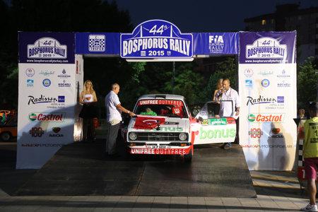 ralli: ISTANBUL, TURKEY - JULY 24, 2015: Burak Turkkan with Ford Escord MK2 of Bonus Unifree Parkur Racing Team in ceremonial start of Bosphorus Rally 2015 Editorial