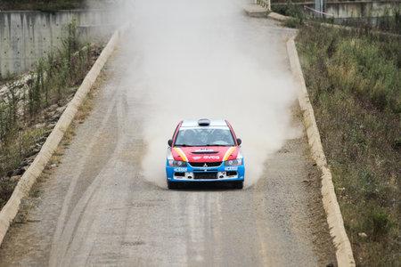 ISTANBUL, TURKEY - JULY 25, 2015: Burcu Cetinkaya drives Mitsubishi Lancer Evo IX of Delta Sport Team in Bosphorus Rally 2015, Deniz stage
