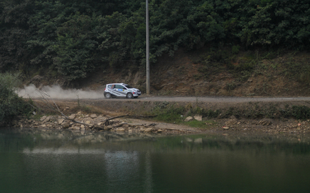 deniz: ISTANBUL, TURKEY - JULY 25, 2015: Yuksel Ozgur drives Citroen C2 GT in Bosphorus Rally 2015, Deniz stage Editorial