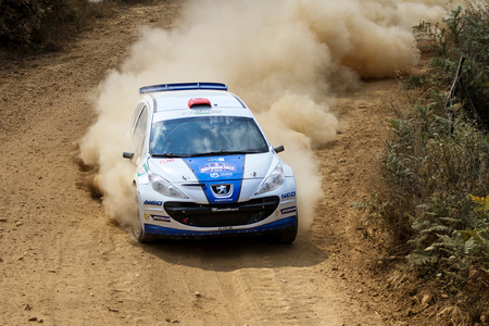 ISTANBUL, TURKEY - JULY 25, 2015: Yagiz Avci drives Peugeot 207 S2000 of Neo Motorspor Team in Bosphorus Rally 2015, Mudarli stage