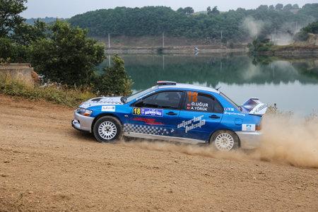 deniz: ISTANBUL, TURKEY - JULY 25, 2015: Osman Ugur drives Mitsubishi Lancer Evo IX in Bosphorus Rally 2015, Deniz stage