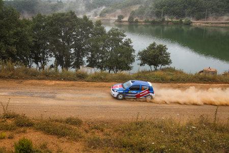deniz: ISTANBUL, TURKEY - JULY 25, 2015: Murat Guray drives Renault Clio RS in Bosphorus Rally 2015, Deniz stage Editorial