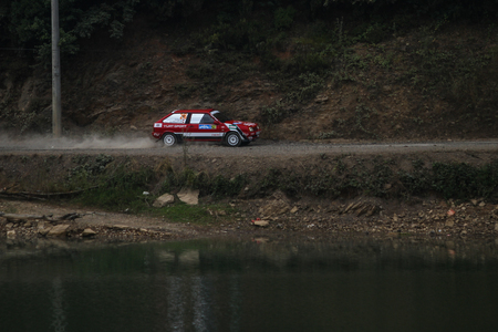 deniz: ISTANBUL, TURKEY - JULY 25, 2015: Umut Gungordu drives Lada Samara in Bosphorus Rally 2015, Deniz stage Editorial