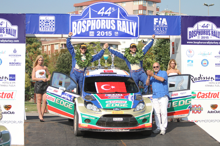ralli: ISTANBUL, TURKEY - JULY 26, 2015: Murat Bostanci with Ford Fiesta S2000 of Castrol Ford Team Turkiye in Podium Ceremony of Bosphorus Rally 2015