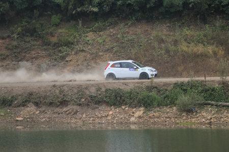 deniz: ISTANBUL, TURKEY - JULY 25, 2015: Cem Alakoc with Ford Fiesta ST of Delta Sport Team in Bosphorus Rally 2015, Deniz stage Editorial