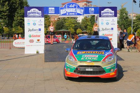 turkiye: ISTANBUL, TURKEY - JULY 26, 2015: Umit Can Ozdemir with Ford Fiesta R2 of Castrol Ford Team Turkiye in Podium Ceremony of Bosphorus Rally 2015