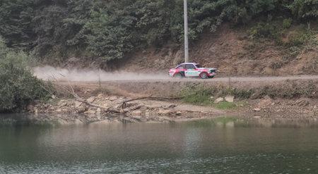 ISTANBUL, TURKEY - JULY 25, 2015: Ercan Kazaz drives Ford Escord MK2 of Bonus Unifree Parkur Racing Team in Bosphorus Rally 2015, Deniz stage