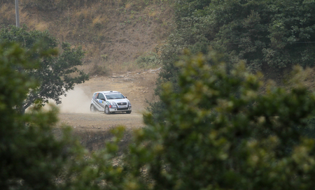 ISTANBUL, TURKEY - JULY 25, 2015: Yuksel Ozgur drives Citroen C2 GT in Bosphorus Rally 2015, Deniz stage Editorial
