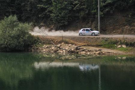 deniz: ISTANBUL, TURKEY - JULY 25, 2015: Murat Ucbasaran drives Peugeot 306 in Bosphorus Rally 2015, Deniz stage