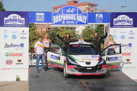 ralli: ISTANBUL, TURKEY - JULY 26, 2015: Hakki Agaoglu with Peugeot 207 S2000 in Podium Ceremony of Bosphorus Rally 2015