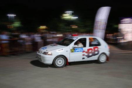 tarik: ISTANBUL, TURKEY - JULY 24, 2015: Tarik Gokcen with Fiat Palio in ceremonial start of Bosphorus Rally 2015