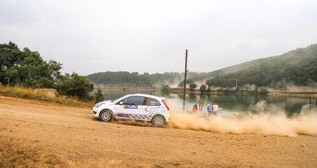 deniz: ISTANBUL, TURKEY - JULY 25, 2015: Turgay Ozdemir drives Ford Fiesta ST in Bosphorus Rally 2015, Deniz stage