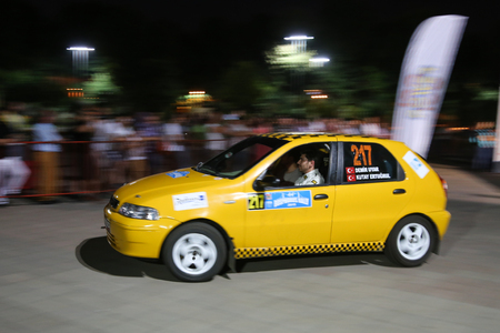 ralli: ISTANBUL, TURKEY - JULY 24, 2015: Demir Uyar with Fiat Palio in ceremonial start of Bosphorus Rally 2015