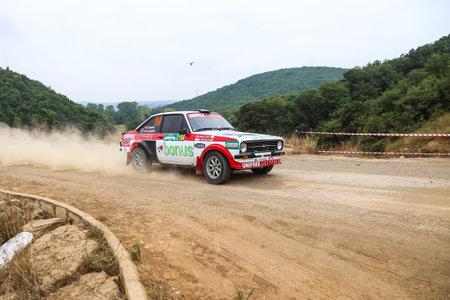 deniz: ISTANBUL, TURKEY - JULY 25, 2015: Ercan Kazaz drives Ford Escord MK2 of Bonus Unifree Parkur Racing Team in Bosphorus Rally 2015, Deniz stage