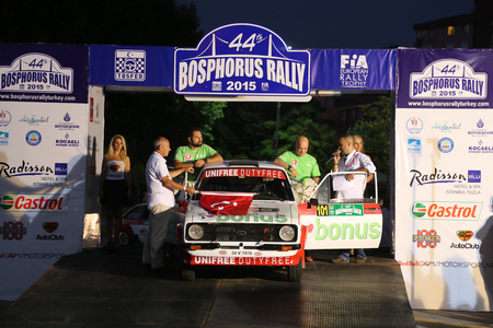 ralli: ISTANBUL, TURKEY - JULY 24, 2015: Engin Kap with Ford Escord MK2 of Bonus Unifree Parkur Racing Team in ceremonial start of Bosphorus Rally 2015 Editorial