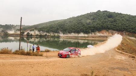 deniz: ISTANBUL, TURKEY - JULY 25, 2015: Georgi Geradzhiev drives Ford Fiesta R2 of Automobile Sport Clup Plovdiv Team in Bosphorus Rally 2015, Deniz stage