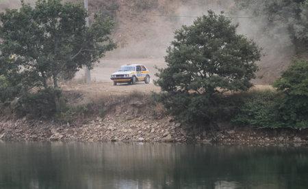 ISTANBUL, TURKEY - JULY 25, 2015: Sinan Dundar drives VW Golf GTI in Bosphorus Rally 2015, Deniz stage
