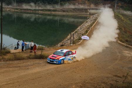 deniz: ISTANBUL, TURKEY - JULY 25, 2015: Burcu Cetinkaya drives Mitsubishi Lancer Evo IX of Delta Sport Team in Bosphorus Rally 2015, Deniz stage