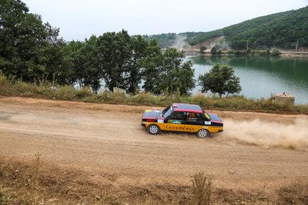 ISTANBUL, TURKEY - JULY 25, 2015: Eris Okutan drives Murat 131 in Bosphorus Rally 2015, Deniz stage