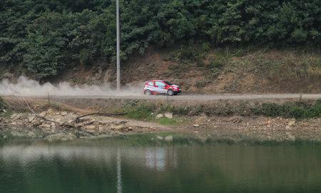 deniz: ISTANBUL, TURKEY - JULY 25, 2015: Alptekin Isikalp drives Citroen C2 GT in Bosphorus Rally 2015, Deniz stage
