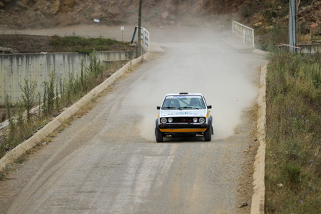 gti: ISTANBUL, TURKEY - JULY 25, 2015: Sinan Dundar drives VW Golf GTI in Bosphorus Rally 2015, Deniz stage