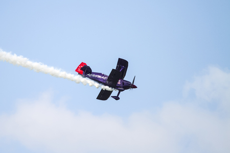 piloting: ISTANBUL, TURKEY - AUGUST 02, 2015: Ali Ismet Ozturk piloting his special biplane called Purple Violet at the TATCA Airfest 2015