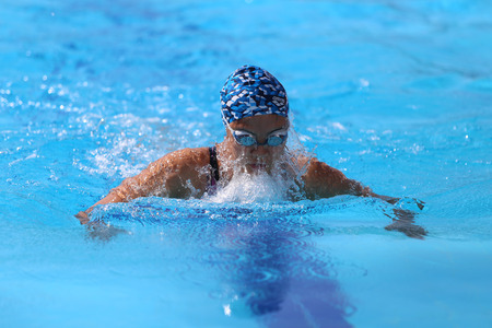swimming race: ISTANBUL, TURKEY - AUGUST 16, 2015: Unidentified competitor swims at the Turkcell Turkish Swimming Championship in Enka Sports Center
