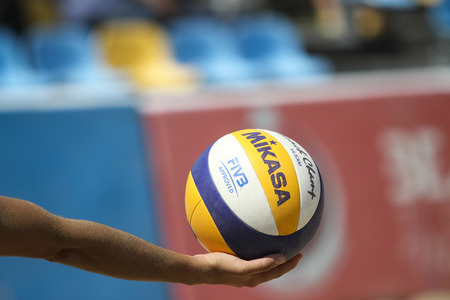 ISTANBUL, TURKEY - AUGUST 09, 2015: Ball in hand of a participants in Kalamis Beach Volleyball court during Nestea Pro Beach Tour Kalamis Open